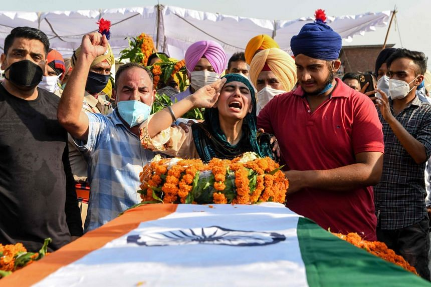 Sandeep Kaur (centre) and brother Prabhjot Singh (second right) mourn the death of their soldier father Satnam Singh in the clash.