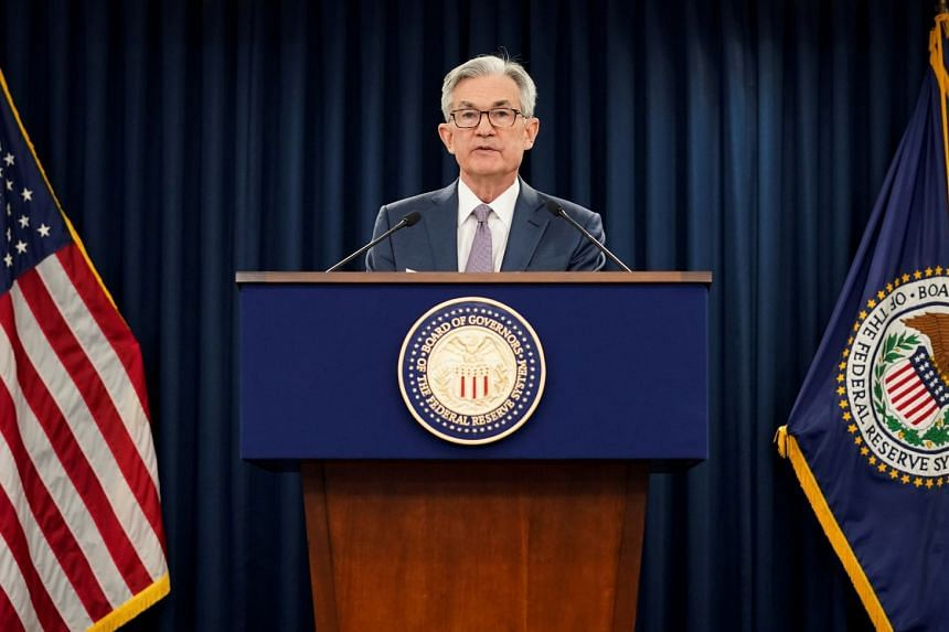 Jerome Powell speaks to reporters in Washington in March 2020.