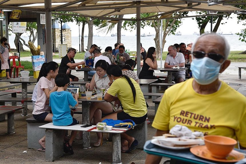 Customers dining in at the East Coast Lagoon Food Village yesterday. Compassion and care for the environment and those around us should be what spurs people to be more hygienic when eating out, says Minister for the Environment and Water Resources Ma