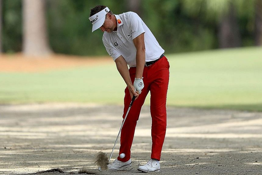 Poulter shares lead at Heritage