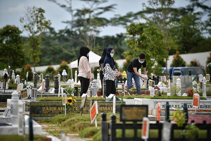 Relatives visiting the graves of their loved ones at the Lim Chu Kang Muslim Cemetery yesterday. ST PHOTO: ARIFFIN JAMAR Left: Breakfast time at 826 Tampines Kopi Point in Tampines Street 81 yesterday. Right: Diners enjoying their meals at a foodcour