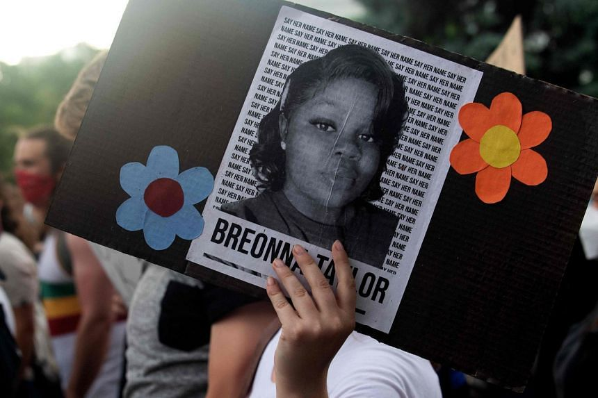 A demonstrator holds a sign with the image of Breonna Taylor during a protest in Denver, Colorado on June 3, 2020.