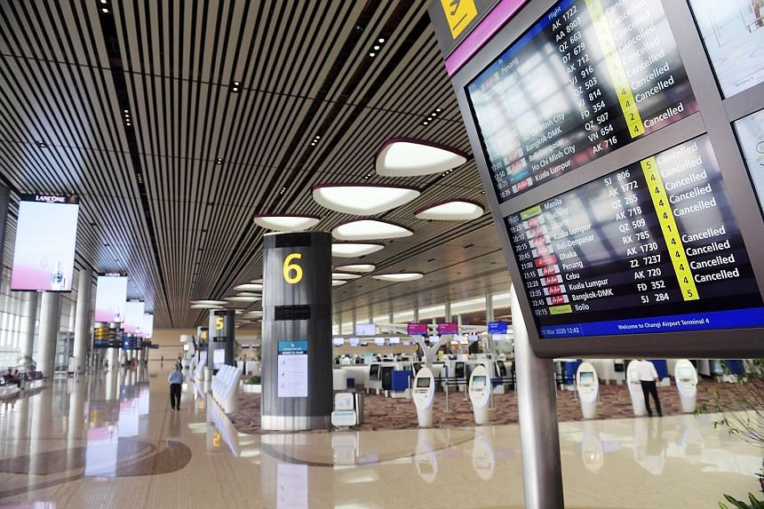 A nearly empty Changi Airport T4 due to cancelled flights in March. Case has urged airlines to offer cash refunds as it is unclear when widespread commercial travel could resume.