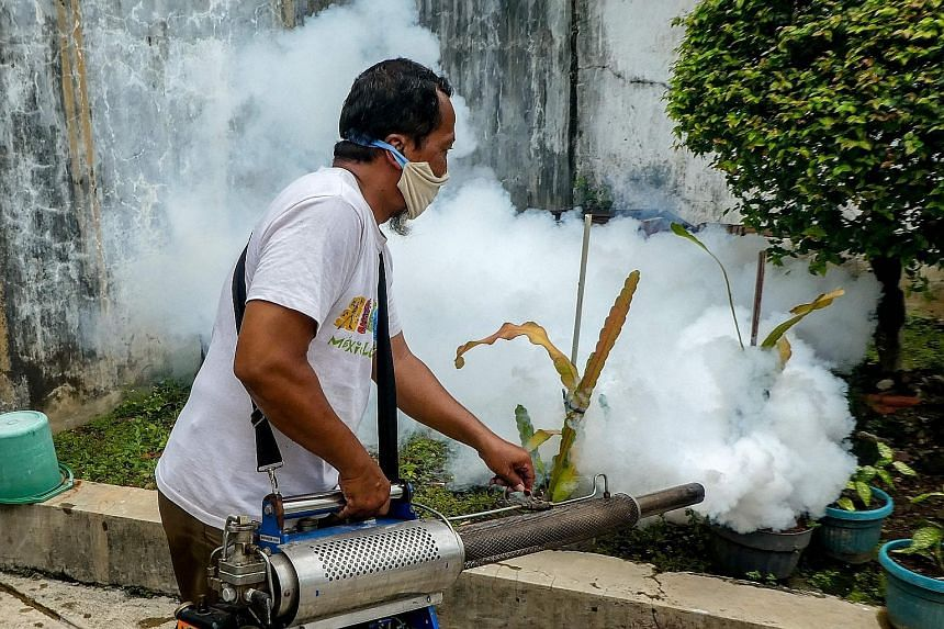 A man carrying out fogging at a housing complex in Jakarta in April. Experts say the restrictions brought about by the Covid-19 pandemic have hampered efforts to prevent dengue fever. PHOTO: AGENCE FRANCE-PRESSE