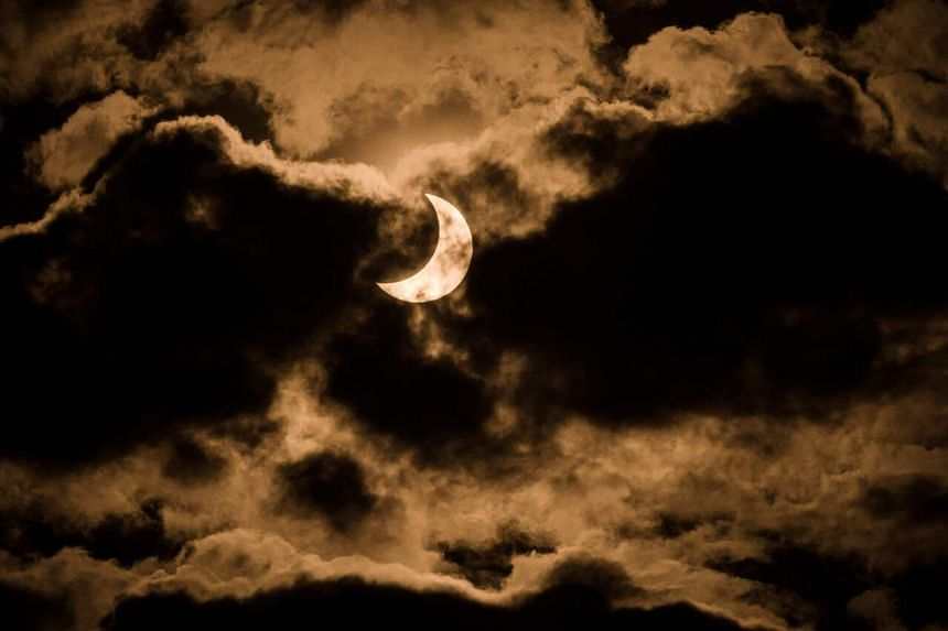 The partial solar eclipse is captured in the cloudy sky in Nairobi, Kenya on June 21, 2020.