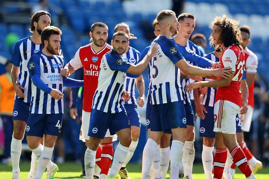 Brighton's French striker Neal Maupay is shielded from Arsenal's French midfielder Matteo Guendouzi after the match.