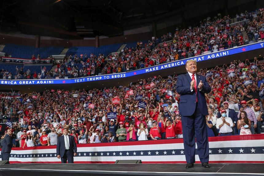 US President Donald Trump takes the stage at his first re-election campaign rally in Oklahoma, on June 20, 2020.