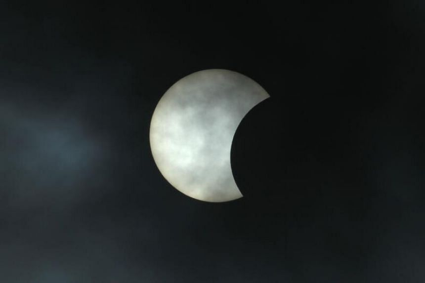 The moon moves in front of the sun during an annular solar eclipse as seen from the Israeli coastal city of Netanya, on June 21, 2020.