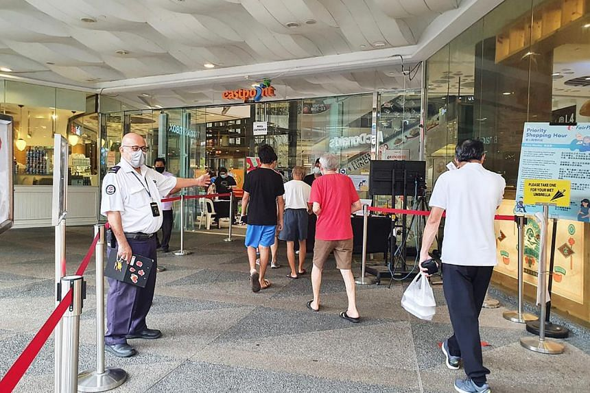 Mall staff facilitating the flow of traffic at the entrance of Eastpoint Mall.