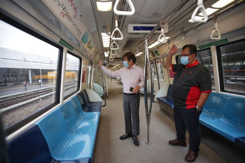 Transport Minister Khaw Boon Wan (left) and rail service manager Hamzah Suria in one of the first-generation trains at Bishan Depot on June 22, 2020.