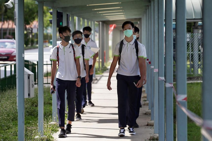 Secondary 4 students wearing masks at Meridian Secondary School, on May 19, 2020.