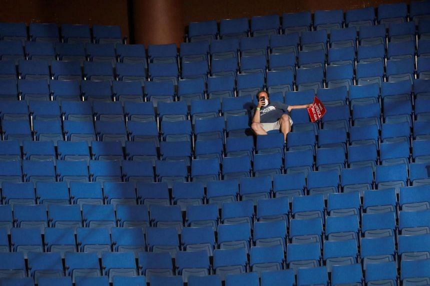 A supporter of US President Donald Trump sitting at the sparsely filled upper decks of the arena as the president addresses his first re-election campaign rally in several months in Tulsa, Oklahoma, on June 20, 2020.