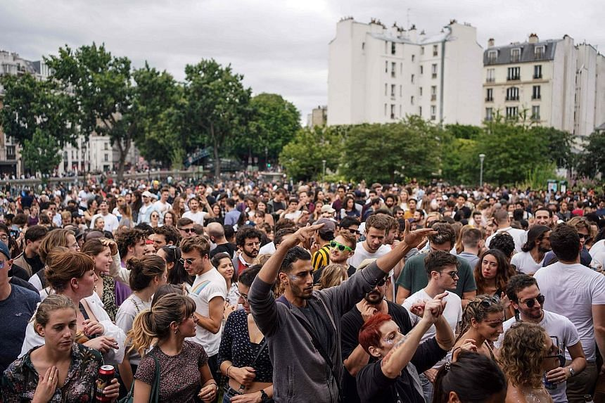 People dancing at the French midsummer Festival of Music at the Villemin garden in Paris on Sunday. But many who watched the crowds on the streets were horrified, taking to social media to voice fears of a second wave of coronavirus infections and cr