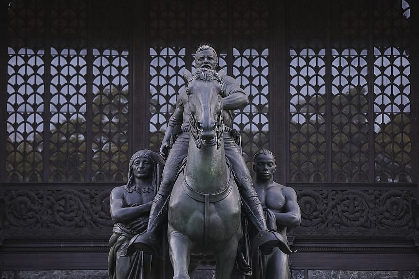 The statue of Theodore Roosevelt, the 26th president of the United States, which has presided outside the American Museum of Natural History in New York City since 1940. For many, it has come to symbolise a painful legacy of colonial expansion and ra