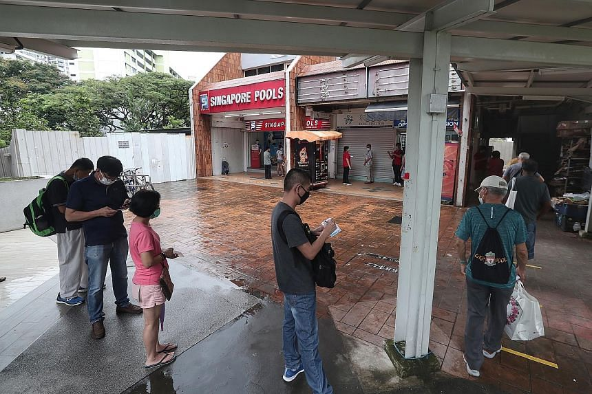 The outlet at Block 446 Clementi Avenue 3 saw a long queue of punters yesterday afternoon, the first day of Singapore Pools' reopening.