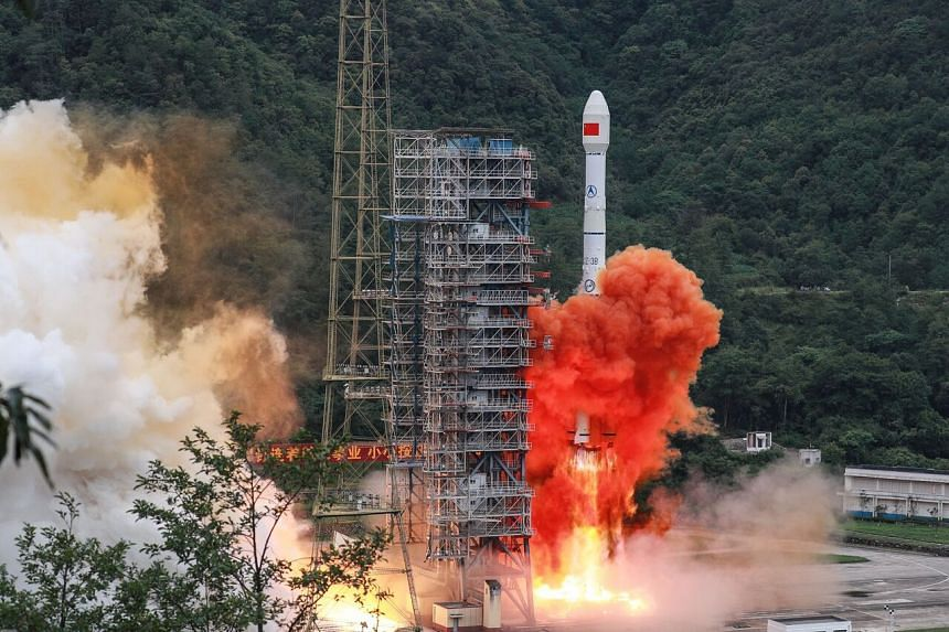 A Long March-3B rocket carrying the Beidou-3GEO3 satellite lifts off from the Xichang Satellite Launch Centre on June 23, 2020.