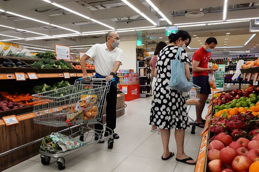 Customers at FairPrice Finest at Junction 8 on May 31, 2020. Food was the only component of the consumer price index to see a faster rise in costs, with prices up by 2.2 per cent year on year last month.