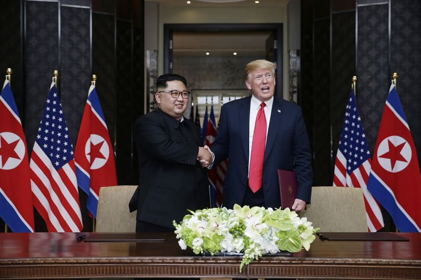 North Korean leader Kim Jong Un and US President Donald Trump shake hands at the Capella Singapore hotel on June 12, 2018.