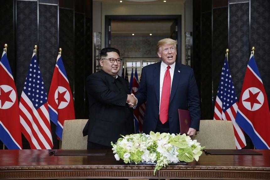 North Korean leader Kim Jong Un and US President Donald Trump shake hands at the Capella Singapore hotel on June 12, 2018.