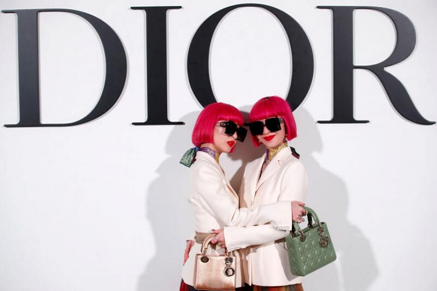Ami and Aya Suzuki pose before Dior Fall/Winter 2020/21 show in Paris.