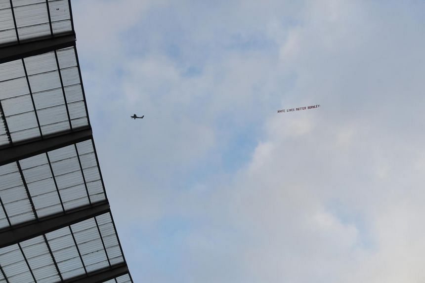 "A ""White Lives Matter Burnley"" sign is seen on a plane above the Etihad stadium on June 22, 2020."