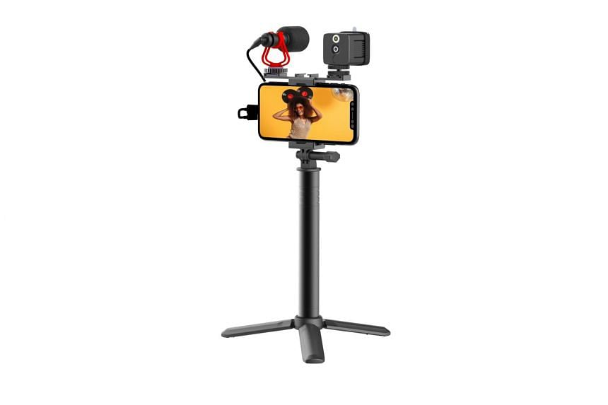 The Moza Mirfak comprises a mini-tripod, an extension pole, a fill light, a microphone and a phone holder.