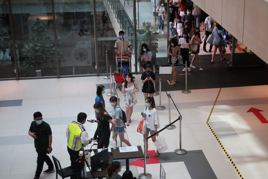 Experts are concerned over crowds forming at malls and eateries in Singapore.