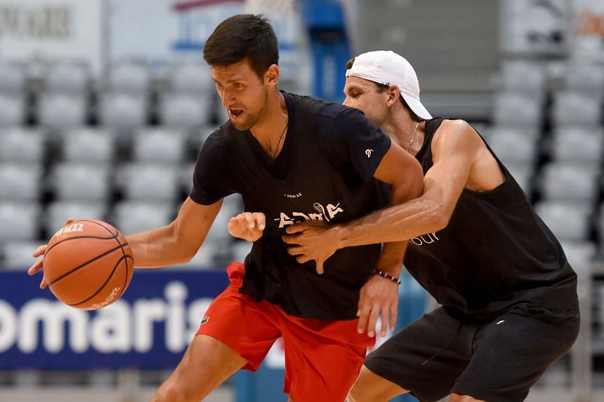 Serbia's Novak Djokovic and Bulgarian Grigor Dimitrov playing in an exhibition basketball game in Zadar, Croatia, during a break in the Adria Tour tennis event. PHOTO: AGENCE FRANCE-PRESSE