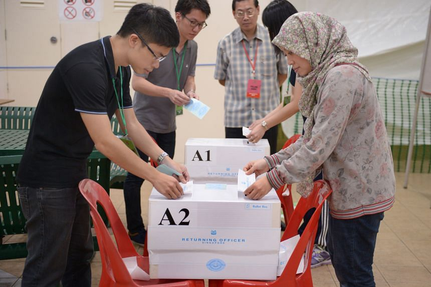 In a photo taken on Sept 11, 2015, ballot boxes are sealed at a polling station in Toa Payoh.