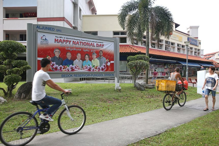 In this picture taken on July 26, 2017, people are seen cycling and walking along Bedok Reservoir.