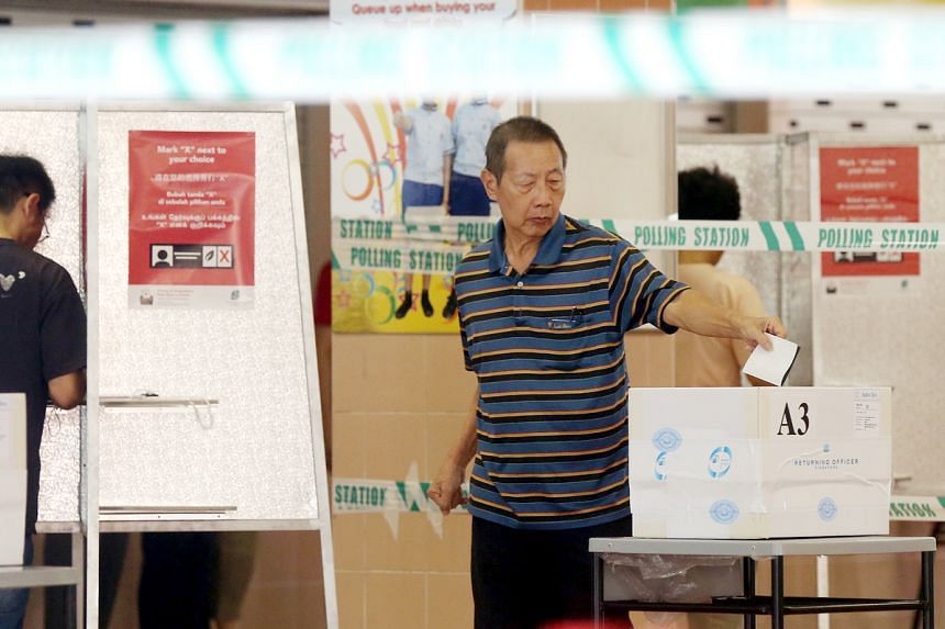 In a photo taken on Sept 11, 2015, during the general election, people cast their votes at Jing Shan Primary School.