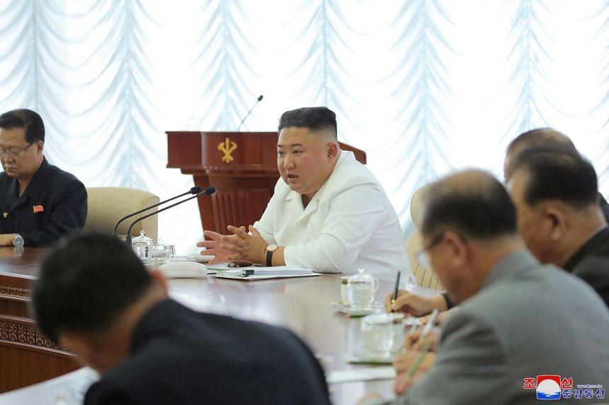 North Korean leader Kim Jong Un speaks during a Workers' Party of Korea meeting.
