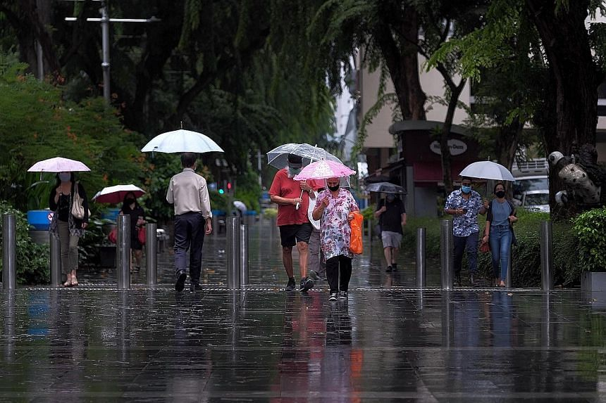 Pedestrians in Orchard Road walking in the rain yesterday morning. Among the areas hit by flash floods, the heaviest rainfall of 108.8mm was recorded in Bedok South.