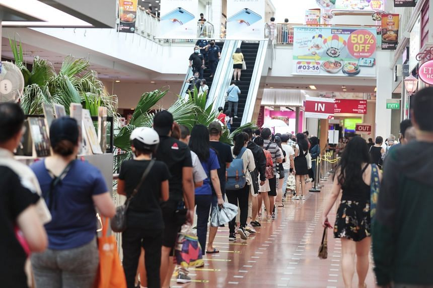 People queueing to enter Jurong Point on June 22, 2020.
