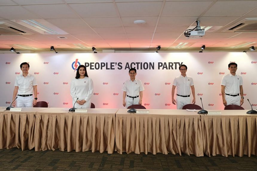 DPM Heng Swee Keat (centre) and new candidates (from left) Ivan Lim, Nadia Ahmad Samdin, Edward Chia and Desmond Tan at the PAP's New Upper Changi Road headquarters on June 24, 2020.