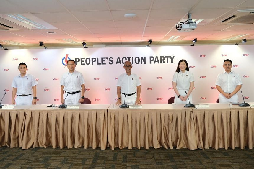 Minister for the Environment and Water Resources Masagos Zulkifli (centre) with new PAP candidates (from left) Yip Hon Weng, Mohd Fahmi Aliman, Hany Soh Hui Bin and Don Wee Boon Hong at the party's New Upper Changi Road headquarters on June 24, 2020.