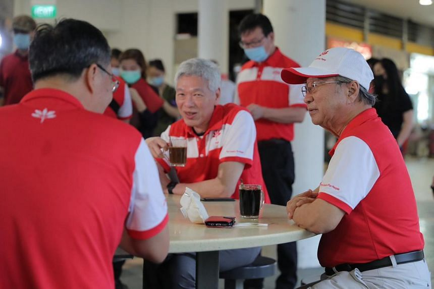 Mr Lee Hsien Yang (centre) and Progress Singapore Party chief Tan Cheng Bock at Tiong Bahru Market on June 24, 2020.