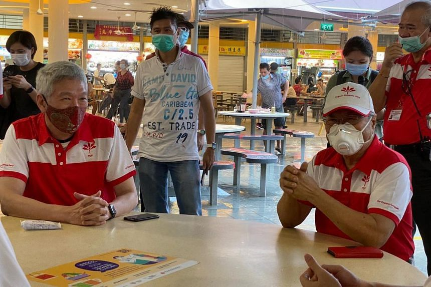 Mr Lee Hsien Yang (left) and Progress Singapore Party chief Tan Cheng Bock at Tiong Bahru Market on June 24, 2020.