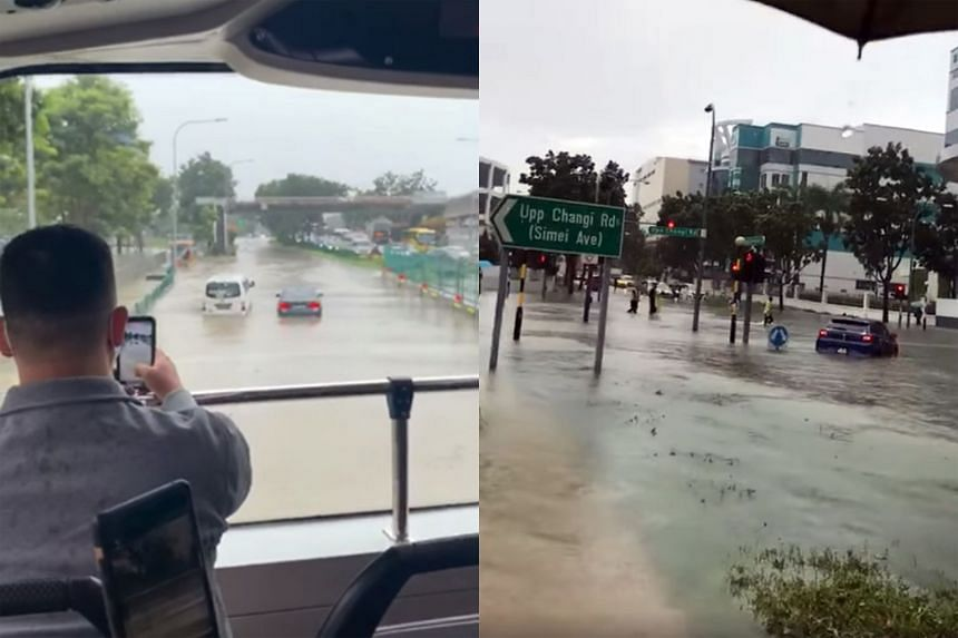 Flash floods due to heavy rain were reported from about 8.30am yesterday, affecting various parts of Singapore, including the intersection of Bedok North Avenue 4 and Upper Changi Road (right), causing vehicles to be partially submerged in floodwater