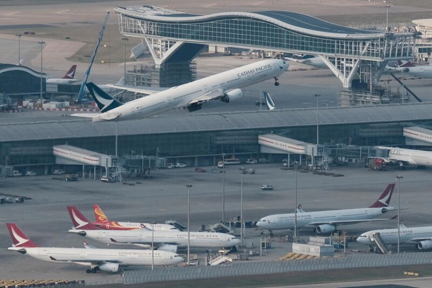 One infected passenger arrived from Manila on a Cathay Pacific Airways flight, and another was on a Cathay Dragon flight from Kuala Lumpur.