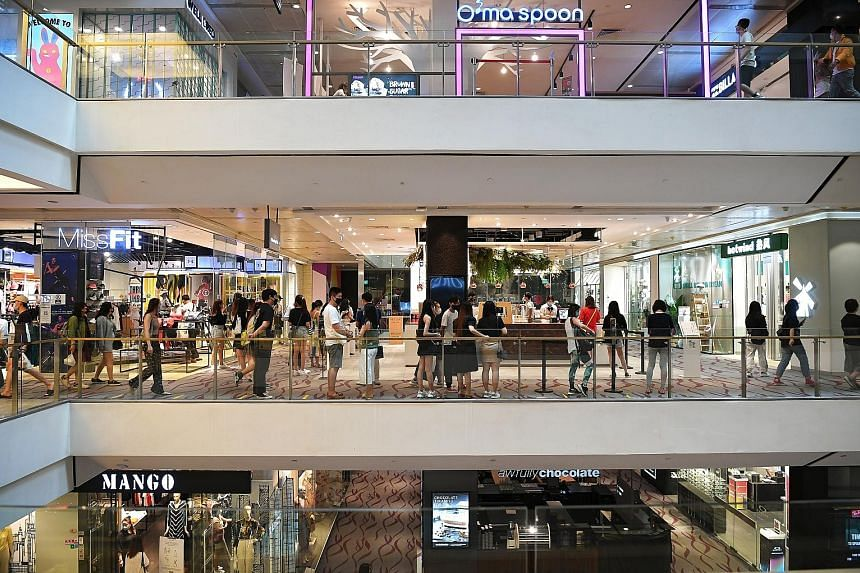 People at 313@somerset mall yesterday. A majority of the employees whose monthly salaries were affected come from sectors severely impacted by Covid-19, such as the retail trade. Most had their salaries cut by up to 25 per cent as a result of cost-sa