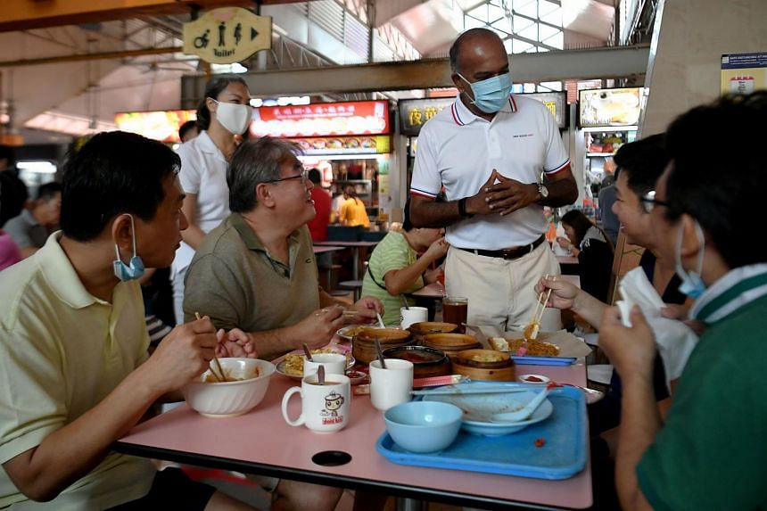 Home Affairs and Law Minister K. Shanmugam, an outgoing MP for Nee Soon GRC, with potential candidate Carrie Tan on a visit to Chong Pang Market and Food Centre on Sunday. The ELD said the same MOH guidelines for the public will also apply to candida