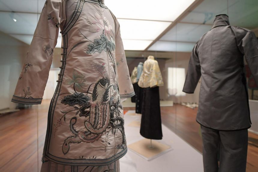 Garments on display at the Asian Civilisations Museum's textile gallery.