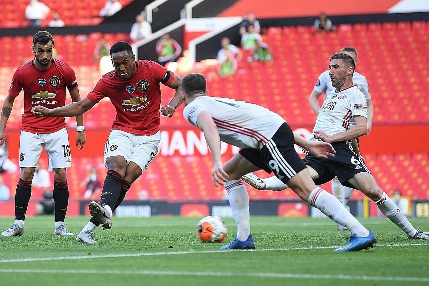 Anthony Martial scoring his and Manchester United's second goal against Sheffield United. The Frenchman later completed a hat-trick.