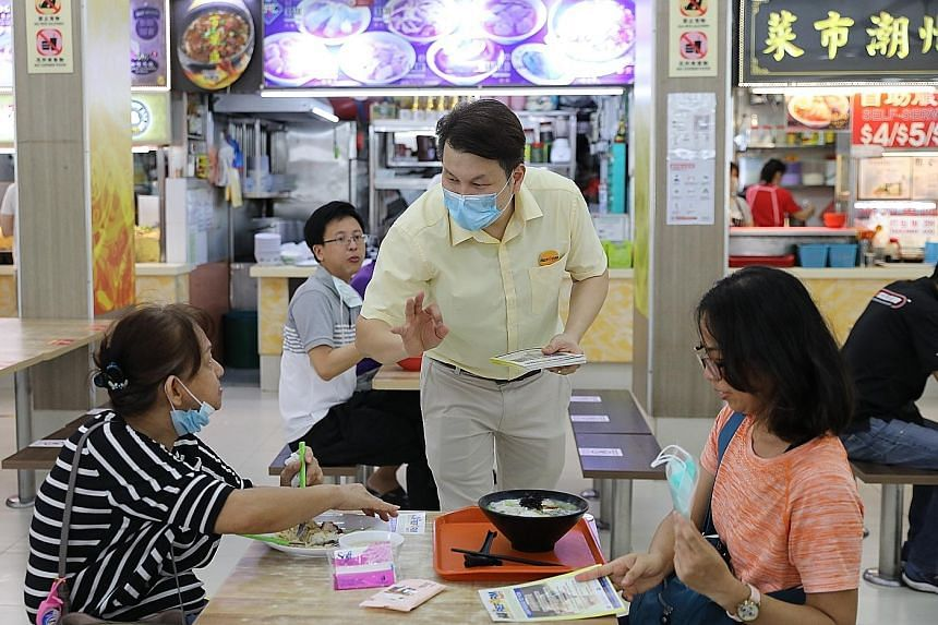 Reform Party chairman Andy Zhu greeting residents on a walkabout in Ang Mo Kio yesterday. The party's secretary-general Kenneth Jeyaretnam, who returned to Singapore yesterday after visiting his son in England, will have to serve a 14-day stay-home n