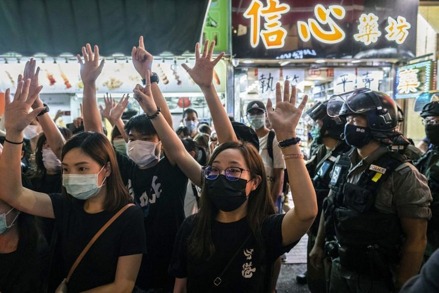 Demonstrators and riot police in Hong Kong on June 12, 2020.