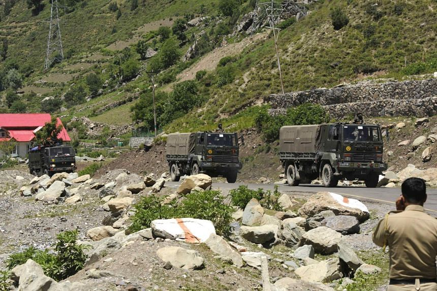 Indian army trucks along a highway in Gagangeer, India, on June 22, 2020.