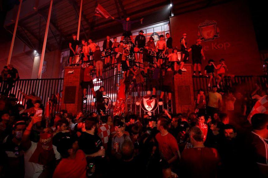 Liverpool fans celebrate winning the Premier League in Britain on June 25, 2020.