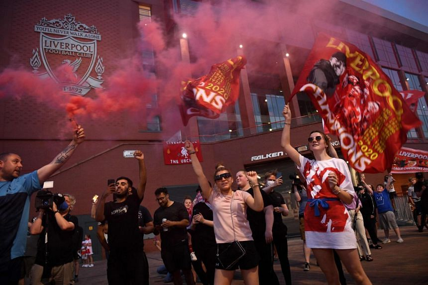Fans celebrate Liverpool winning the championship title in Liverpool, England, on June 25, 2020.
