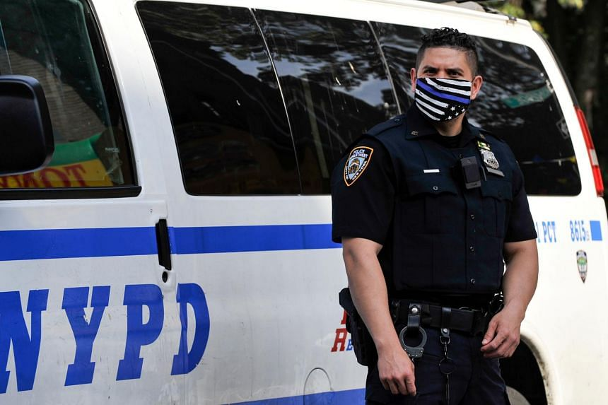 A NYPD police officer at the scene of a shooting in Brooklyn, New York, on June 25, 2020.